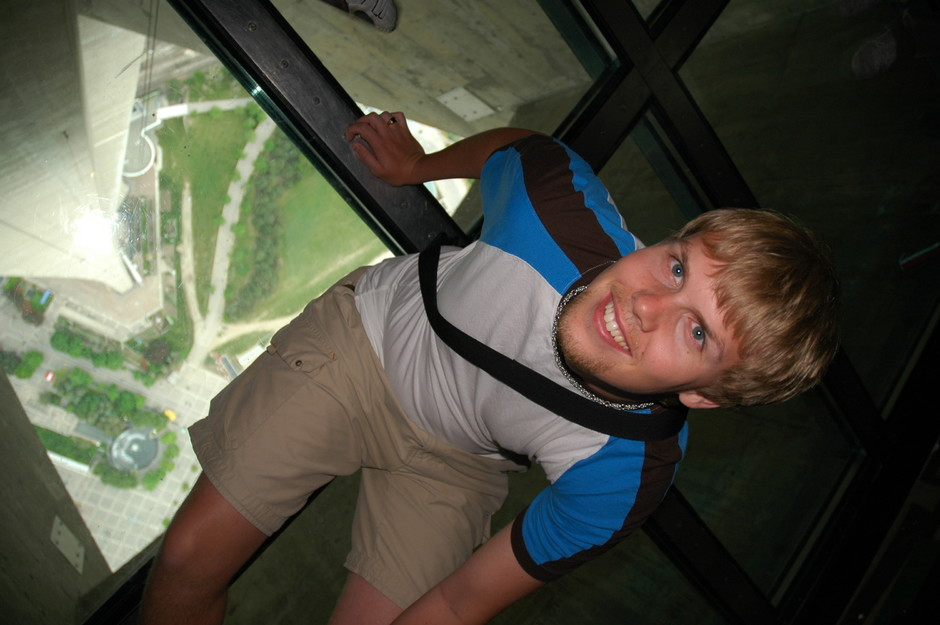Me on glass floor in CN Tower, Toronto